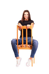 Woman sitting backwards on the chair posing
