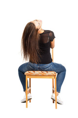 Long hair brunette siting backwards on the chair