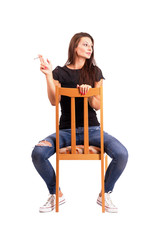 Young woman smoking cigarette on the chair