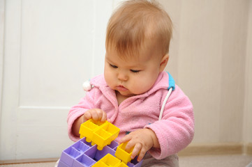 Baby playing with colored constructor