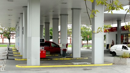 fuel station - cars and people - tree
