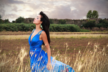 A brunette girl with an electric blue dress