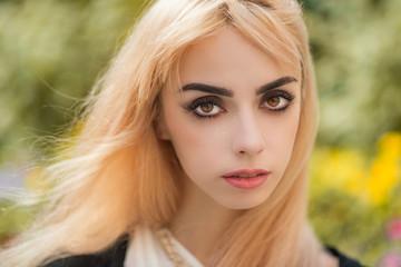 Portrait of a beautiful blonde girl close-up.