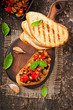 Bruschetta caponata with raisins and pine nuts decorated with a
