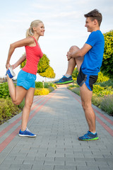 Smiling sport couple training in park