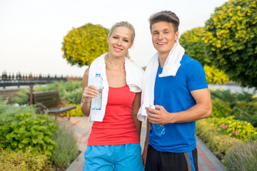 Young couple after running in park