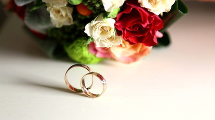 Wedding rings and wedding bouquet.
