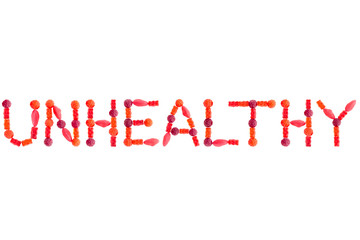 "Word ""UNHEALTHY"" made of red sugary candies, isolated"