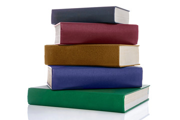 Stack of five hardback books isolated on white