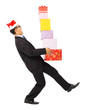 businessman holding gift boxes and scared to fall.