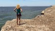 Young Girl at the dried seaweed coast. Sicily