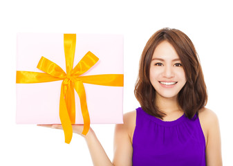 closeup of happy young woman holding a gift box