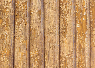 Peeling paint on a wooden wall background