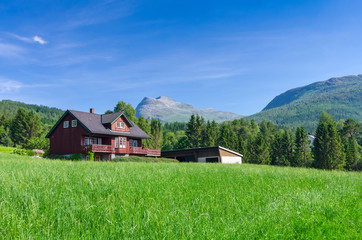 Typical Norwegian village house under the mountains