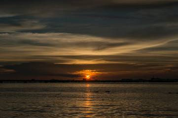 silhouette of Laem Chabang seaside at Sriracha with sunset sky
