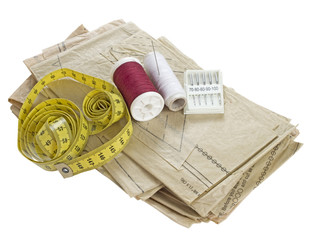 Sewing, dressmaking materials. Pattern, thread, tape measure etc