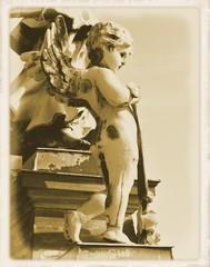 Vintage postcard depicting old statue of angel