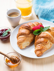 breakfast with croissants,coffee and juice
