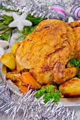 Chicken Christmas with vegetables and silver tinsel