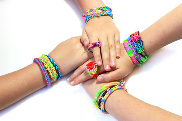 Elastic and colorful rainbow loom bracelet on hands