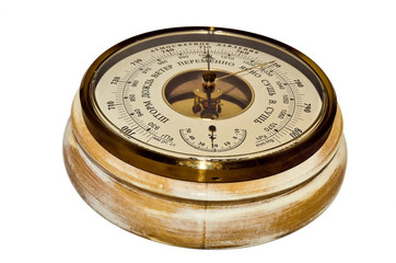 Round wooden barometer on a white background