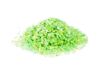 Green sea salt for bathing on a white background
