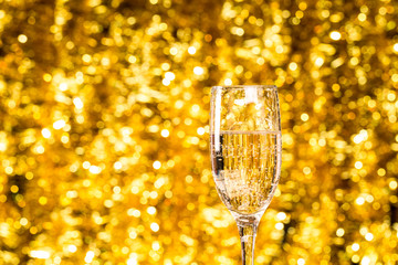 One champagne glass on christmas bokeh background ackground