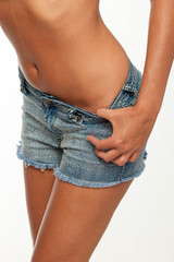 Beautiful woman body with denim jeans shorts