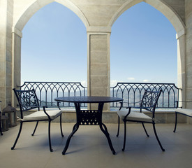 Table with chairs on a mountain view terrace