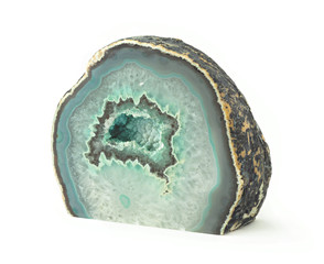 green agate geode rock with crystals isolated on white