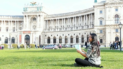 woman studying map near the Austrian National Library