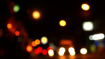Blurred Defocused Lights of Traffic on Road at Night. Speed up.