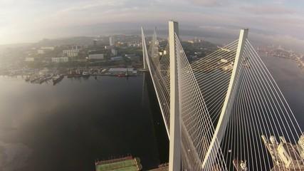Flying above long bridge.