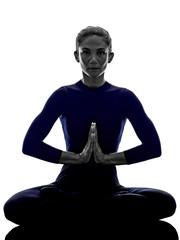 woman exercising Padmasana lotus pose yoga silhouette