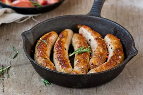 Foto op Canvas Vlees fried sausages on a frying pan