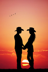 cowboy and cowgirl at sunset