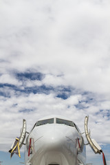 Plane Under the Clouds