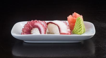 japanese cuisine. sushi octopus on the background