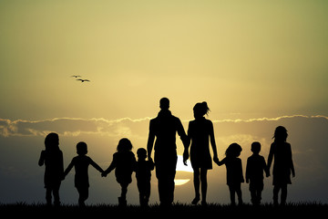 big family at sunset