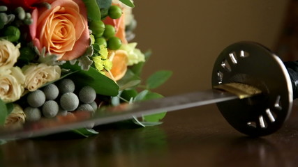Samurai katana and the bridal bouquet.