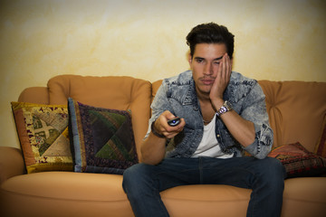 Young man sitting watching television