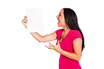 Angry woman shouting at piece of paper