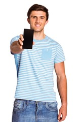 Young man showing phone to camera