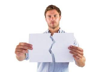 Man holding torn white paper