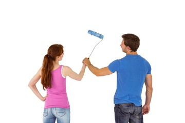 Couple painting a wall together