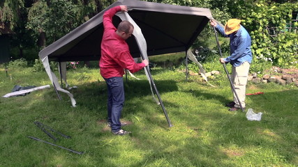 People stand garden tent bower roof on long metal legs