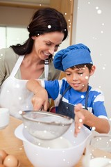 Mother and son baking together