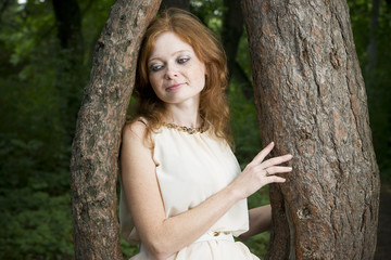 Portrait of redhead girl on nature