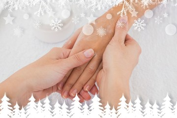 Composite image of hands applying cream