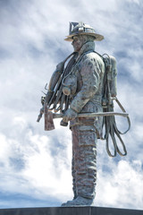 Fireman Statue on the light blue sky background